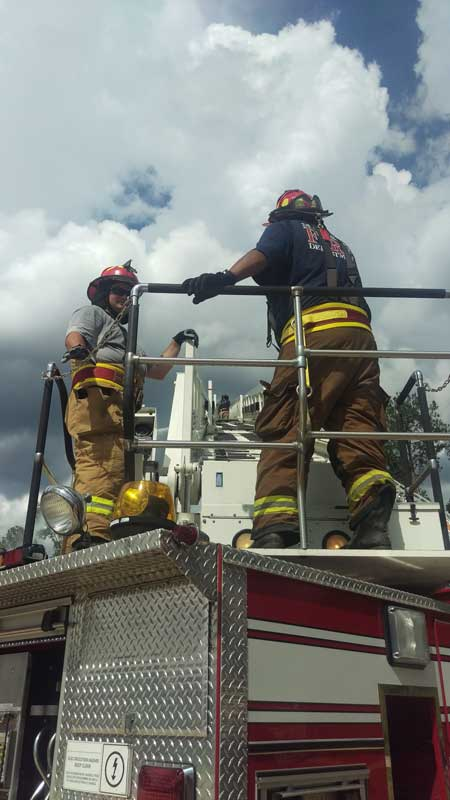 Fire fighters on a truck