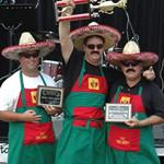 Winners with trophy for the chili competition.