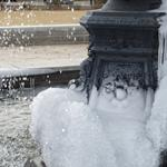 Winter brings ice to freeze the base of the Cooke Fountain.