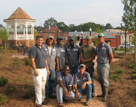 City workers pose for a picture after finishing the upper patio installation.